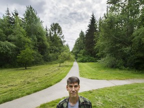 Steven Pettigrew stands in Hawthorne Park near his home in Surrey. Pettigrew is concerned about city plans to build a road through the park.
