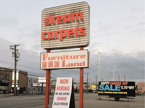 "Furniture Land outlet owner Sam Manji says in a newspaper ad that ""our error was in the wording"" of the help wanted sign."