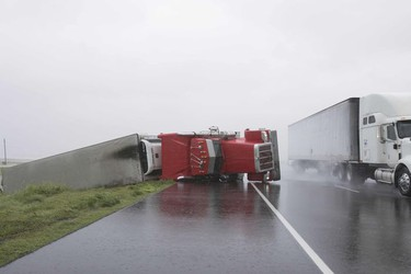 TOPSHOT-US-WEATHER-STORM-HARVEY  TOPSHOT - A big rig lies on it's side on Hwy 59 near Edna, Texas, south of Houston, in the aftermath of Hurricane Harvey on August 26, 2017.  / AFP PHOTO / Daniel KRAMERDANIEL KRAMER/AFP/Getty Images ORG XMIT: Hurricane DANIEL KRAMER, AFP/Getty Images