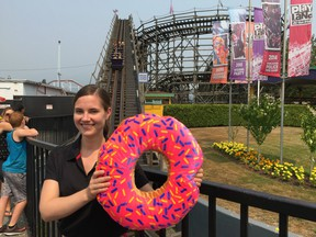 Upbeat Lisa Modica-Amore, the new director of Playland Operations, played along Wednesday in helping to promote the third annual PNE Donut Dash 5K Run, which is scheduled for Sunday, Aug. 20.