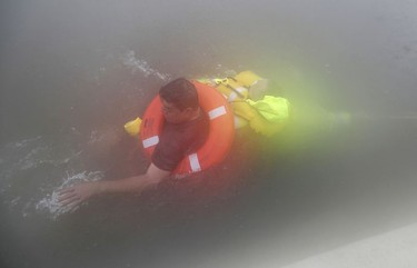 Wilford Martinez, left, is rescued from his flooded car along Interstate 610 in floodwaters from Tropical Storm Harvey on Sunday, Aug. 27, 2017, in Houston, Texas.