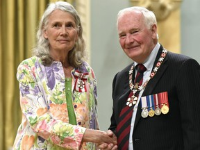 Jean Swanson, Vancouver poverty and homelessness activist, is invested as a member of the Order of Canada by Gov. Gen. David Johnston during a ceremony at Rideau Hall in Ottawa on Friday, August 25, 2017.
