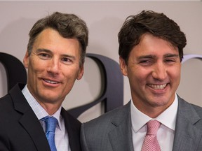 Vancouver Mayor Gregor Robertson and Prime Minister Justin Trudeau get up close prior to their private meeting in Vancouver on Tuesday.