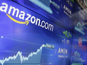 In this May 30 file photo, the Amazon logo is displayed at the Nasdaq MarketSite, in New York's Times Square. Amazon announced Sept. 7 that it has opened the search for a second headquarters, promising to spend more than US$5 billion on the opening.