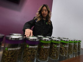 FILE PHOTO - A salesperson prepares an order of marijuana products at the Perennial Holistic Wellness Center which is a medicinal marijuana dispensary in Los Angeles, California on March 24, 2017.