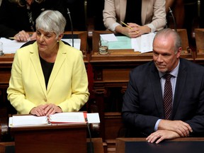 B.C. Finance Minister Carole James delivers the budget as Premier John Horgan looks on.