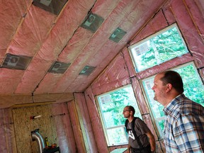 Nathan Stone (right), co-founder of building development company Odessa Group, credits his involvement in the Local Energy Efficiency Partnership (LEEP) program for helping him learn innovative building techniques to make his homes even more efficient.