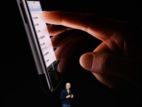 CEO Tim Cook talks about Apple's new iPhones at the company's California headquarters on Sept. 12, 2017