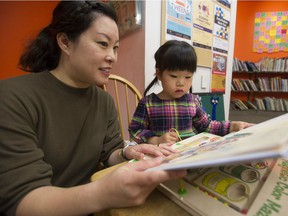 Heidi Leung reads a book with her daughter Madeline Chong at the Oakridge VPL branch in Vancouver. Madeline is enrolled in sensory storytime, a program for children who have various troubles being in larger groups.