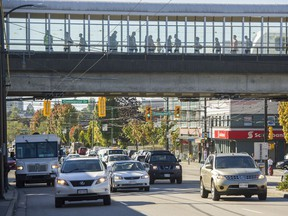 The walkway over-pass  at Commercial and East Broadway in Vancouver in 2016. A new section has been added which help customers move between the two sections of the station.