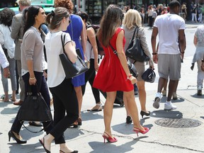 Stylish Montrealers walk on Ste-Catherine St. in July 2016.