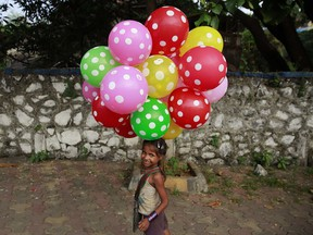 Lali carries balloons to sell on a beach in Mumbai, India, in October 2015. The UN General Assembly marks Oct. 11 as the International Day of the Girl Child, to recognize girls' rights and the unique challenges girls face around the world.