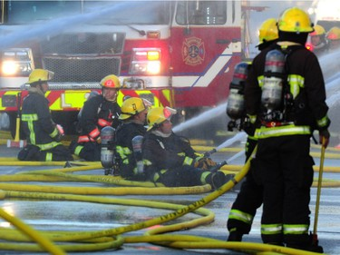 Vancouver Fire Department fighting a two alarm fire on East 3rd Ave between Ontario and Quebec St in Vancouver, BC., October 3, 2017. Several explosions were heard from an Auto repair shop and a Doggie Daycare next door was evacuated with no injuries reported.