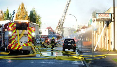 Vancouver Fire Department fighting a two alarm fire on East 3rd Ave between Ontario and Quebec St in Vancouver, BC, Oct. 3, 2017.