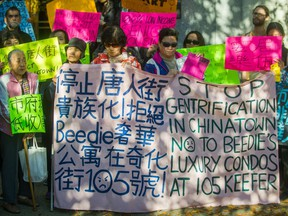 Chinatown residents rally in front of Vancouver City Hall on Monday.