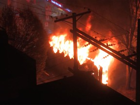 A party bus burns on Granville Street on Saturday night.