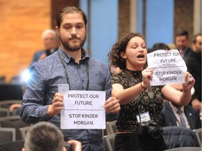 Anti-Kinder Morgan protesters Jake Hubley and Hayley Zacks heckle Prime Minister Justin Trudeau at the UN Peacekeeping Defence Ministerial Conference in Vancouver, BC., November 15, 2017.