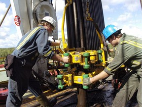 Roughnecks work on a drill rig in the Fort St. John area.