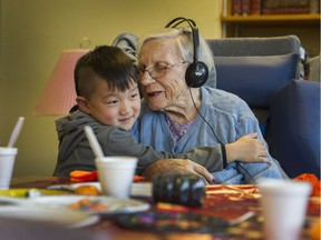 FILE PHOTO - 5 year old Tony Han Jr. with 100 year old Alice Clark at Youville Residence care facility in Vancouver, BC., October 26, 2016.
