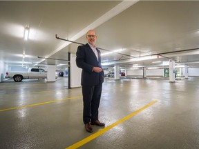 Ross Moore, senior vice-president at Cresa Vancouver, in a near empty underground parking lot in Vancouver.