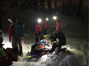 North Shore Rescue volunteers worked well into the evening Tuesday to get a skier injured in an avalanche off Mount Seymour.