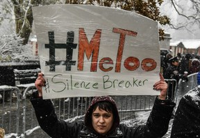 People carry signs addressing the issue of sexual harassment at a #MeToo rally on December 9, 2017 in New York City.