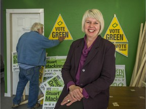 Adriane Carr and husband Paul are shown at Green Party of Vancouver headquarters in 2014, when Carr topped polls among city councillors. She says she is 'ready and willing' to run for mayor this year.