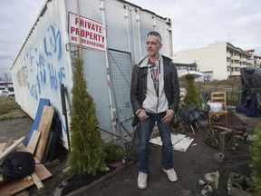 Jay Post outside the disused container he has taken over for a home.