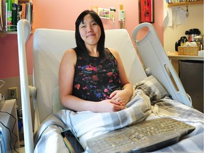 Taeshim Youn, who is legally blind has launched a petition to try to get the provincial government to fund an online audio book library that she will no longer have access to at the end of this month, in Port Moody, BC., January 15, 2018.