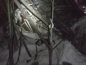 Search and rescue crews from Chilliwack and Hope performed a rope rescue to pull the driver out of this truck that fell 90 feet off an embankment Monday along Highway 5.