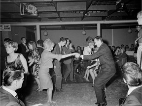 """Sept. 26, 1966. Patrons dance at the Pink Pussycat Cabaret in Vancouver. The Pink Pussycat was one of many nightclubs in the '60s that operated as a """"bottle club,"""" allowing customers to smuggle in their own alcohol because the club didn't have a liquor licence. George Diack/Vancouver Sun"""