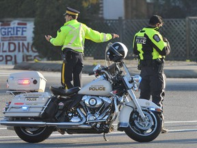 Police direct traffic during a standoff in New Westminster on November 8, 2012.
