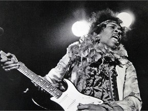 In this June 18, 1967 file photo, Jimi Hendrix performs at the Monterey Pop Festival in Monterey, Calif.