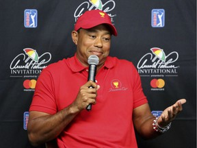 Tiger Woods's fortunes —and golf's — are revived in the wake of last weekend's second-place showing at the Valspar Championships. Here a loose Woods shrugs during a news conference on Tuesday at Bay Hill in Orlando, Fla. (Photo: Joe Burbank, Orlando Sentinel via Associated Press)
