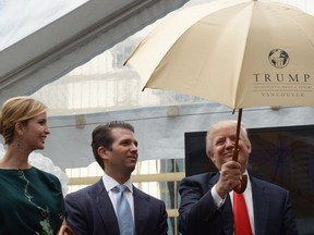 Ivanka Trump, left with brother Donald Jr. and father Donald Trump, in Vancouver in 2013. CNN says she is under investigation by the FBI for business dealings including the Trump Tower in Vancouver.