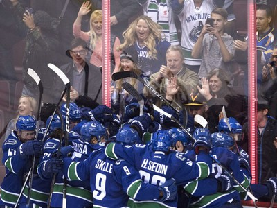 Oct. 18, 2016: Vancouver Canucks centre Henrik Sedin (33) celebrates his game winning goal over the St. Louis Blues with his teammates following overtime during NHL action