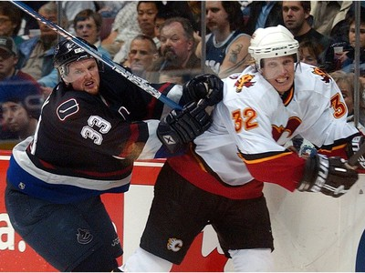 April 9, 2004: Center Henrik Sedin (33) chases   Calgary Flames' defenceman Toni Lydman (32) during third period Game two Western Conference playoff.