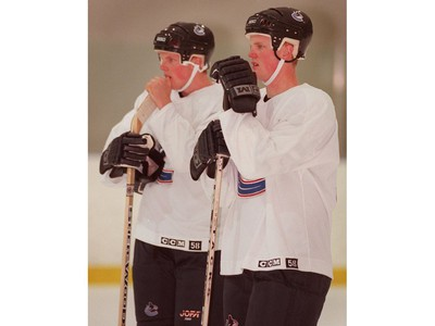 July 7, 2000: L-R Daniel and Henrik Sedin  watch the action during an on ice session at the Twist training camp.