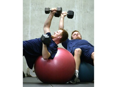 Sept. 17, 2006: Daniel, front, lifts some weights with his brother Henrik Sedin during some off ice training in Vernon.