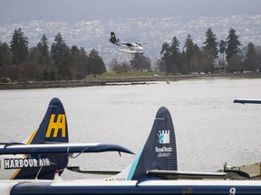 A Harbour Air seaplane lands at in Vancouver Wednesday. Harbour Air and Seattle's Kenmore Air plan to launch 20 flights a week between Vancouver's Coal Harbour and Seattle's Lake Union on April 26.
