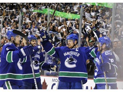 MAY 18, 2011 - Vancouver Canucks celebrate a goal by Daniel Sedin(R)  against San Jose Sharks in the third period of Game Two of the Western Conference Finals.