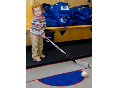 Apr. 6, 2008: A way too cute little Sedin. Two-year-old Ronja Sedin practised a shot while her dad Daniel speaks to the media. Vancouver Canuck players speak to the media and clear out their lockers at GM Place on Sunday afternoon after the team failed to make the 2008 NHL playoffs.