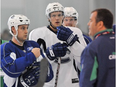 Sept. 21 2008: Canucks (M) Alexander Edler listens to coach Alain Vigneault with Kyle Wellwood and Daniel Sedin during training camp at Meadow Park Sports Centre in Whistler.