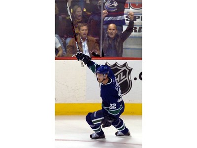 Oct. 13, 2006: VDaniel Sedin celebrates his goal with fans  in game against San Jose Sharks in NHL opener at Gm Place.