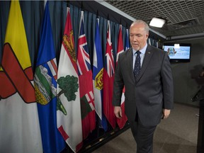 B.C. Premier John Horgan leaves a press conference in Ottawa on Sunday, after discussing his meeting with Prime Minister Justin Trudeau and Alberta Premier Rachel Notley on the deadlock over Kinder Morgan's Trans Mountain pipeline expansion.