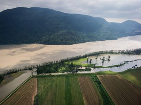 Flooded farmland is seen along the Fraser River in an aerial view near Abbotsford, B.C., on Wednesday May 16, 2018.
