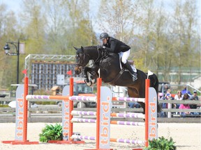 Vancouver's Chris Lowe and his equine partner Cunningham, seen here in action, will be part of the field of competitors at the Vancouver Grand Prix show jumping event on in downtown Vancouver on May 20, 2018.