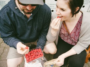The Fraser Valley is a hotspot for food and drink. Tyler and Cassie Duft of Duft & Co. are pictured enjoying local raspberries. Handout/Tourism Abbotsford [PNG Merlin Archive]