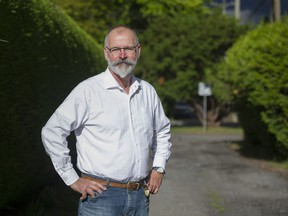 Entrepreneur Duane Laird in a westside neighbourhood where laneway housing is allowed, Vancouver June 14 2018.