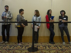 """When a sample of residents of affluent nations were asked if they supported government programs that would """"provide jobs for everyone who wants one,"""" there was significant resistance. {File photo: People line up for a job fair in Vancouver.)"""